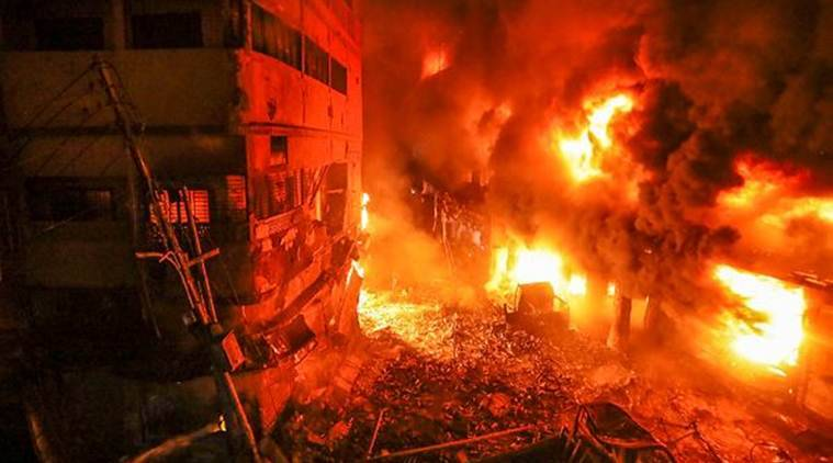 Flames rise fire from a fire in a densely packed shopping area in Dhaka on Thursday. (AP)