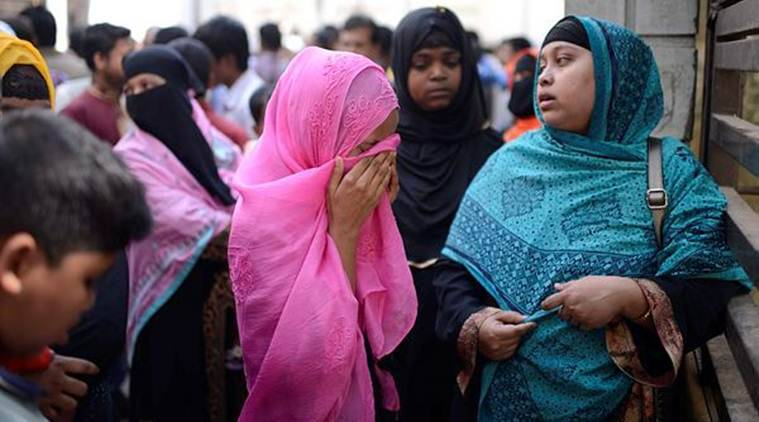 A woman cries outside a morgue in Dhaka on Thursday. (AP)