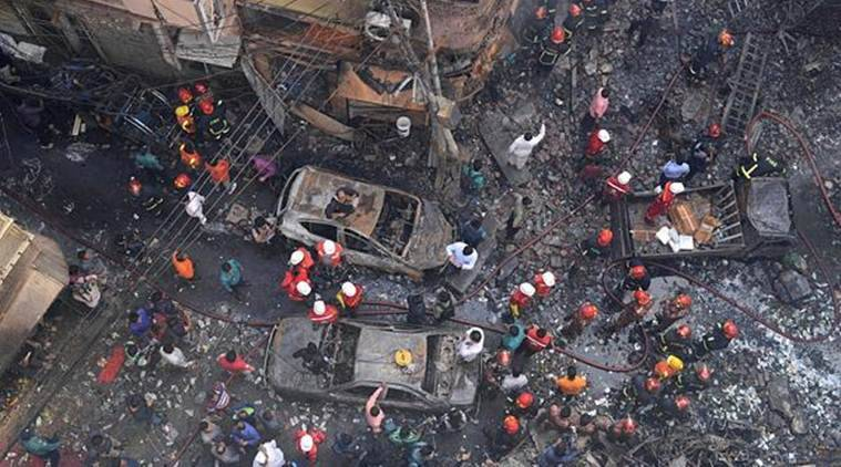 Rescuers stand at the site of the incident. (AP)