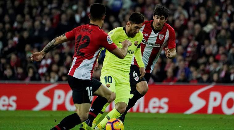 Barcelona's Lionel Messi in action with Athletic Bilbao's Mikel San Jose and Yuri Berchiche