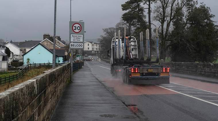 A truck crosses a bridge from Blacklion, Ireland, into Belcoo, a village in Northern Ireland.