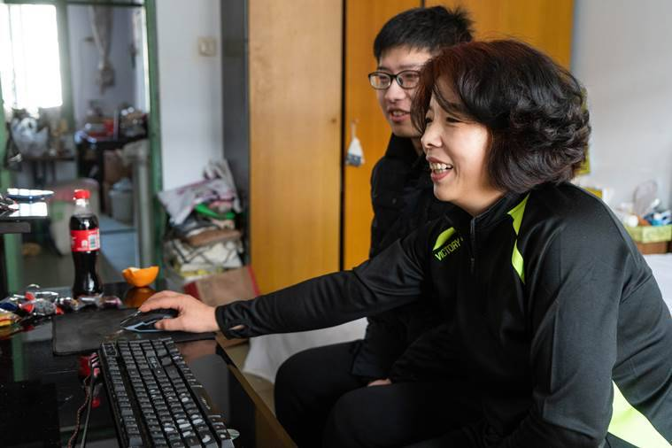 "a professional blogger, plays the video game ""Chinese Parents"" with his mother at home in Qinhuangdao, China"