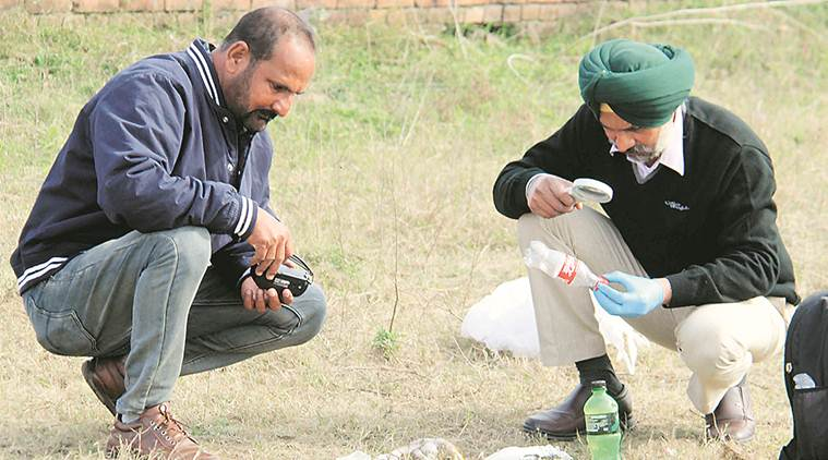 A forensic expert examines the spot where the incident took place, in Ludhiana on Monday. (Express photo/Gurmeet Singh)