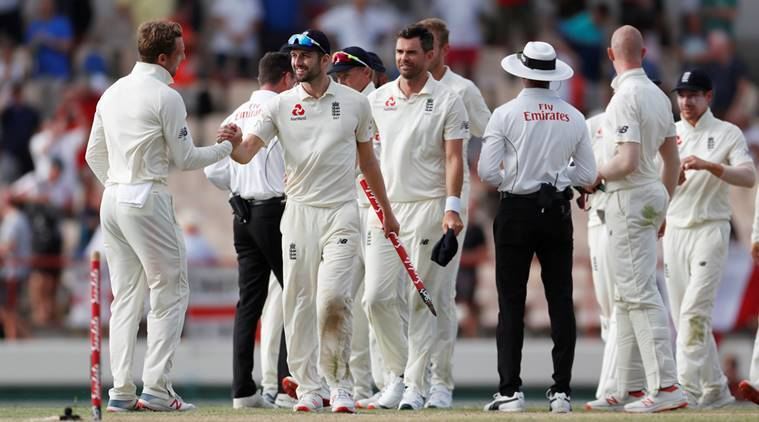 England's Mark Wood celebrates with team mates after the match against West Indies