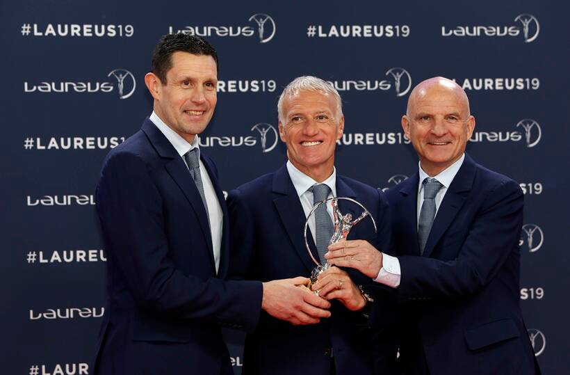 French soccer team head coach Didier Deschamps, center, his goalkeeper coach Franck Raviot and assistant coach Guy Stephanon, right, hold the World team of the year award during the 2019 Laureus World Sports Awards