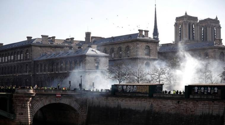 yellow vest protests, france yellow vest protests, yellow vest protest in france, france protests, paris, emmanuel macron, tear gas, hate speech, world news, indian express news