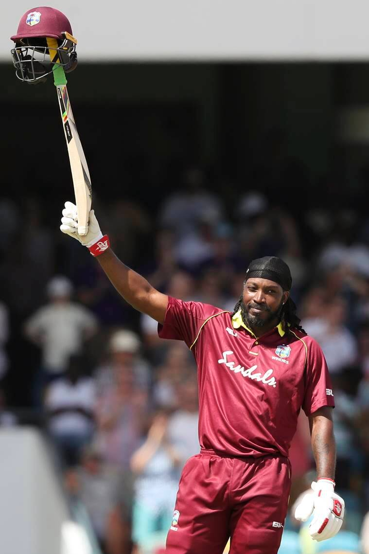 West Indies' Chris Gayle celebrates after he scored a century against England during the first One Day International cricket match at the Kensington Oval in Bridgetown, Barbados