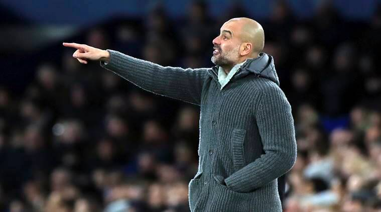 Manchester City manager Pep Guardiola gestures on the touchline during their English Premier League soccer match against Everton at Goodison Park, Liverpool, England