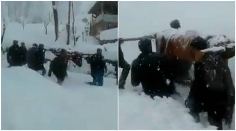 Watch: People Carry Pregnant Lady To Hospital Amid Snowfall In Kashmir