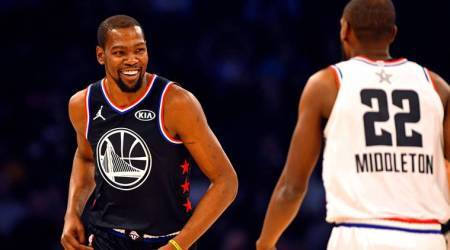 Team Lebron forward Kevin Durant of the Golden State Warrior (35) reacts with Team Giannis forward Khris Middleton of the Milwaukee Bucks (22) during the 2019 NBA All-Star Game at Spectrum Center.