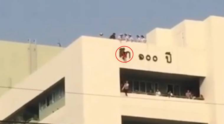 Thailand, Thailand hospital, four year old hangs hospital roof, kid hangs hospital roof, toddler rescued hospital roof, viral video