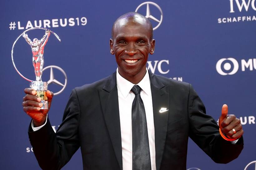 Eliud Kipchoge poses after winning the Exceptional Achievement Award