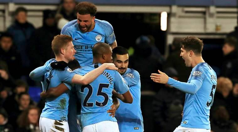 Manchester City's Gabriel Jesus, obscured, celebrates with teammates after scoring his side's second goal of the game against Everton during an English Premier League soccer match at Goodison Park, Liverpool