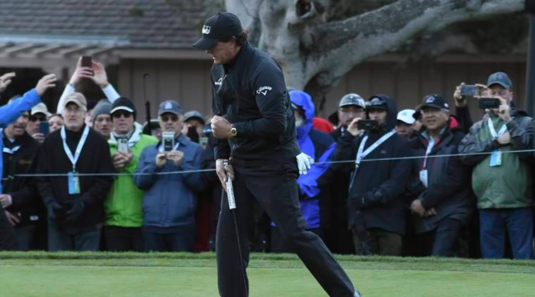 Phil Mickelson celebrates his birdie at the 15th hole during the final round of the AT&T Pebble Beach Pro-Am golf tournament at Pebble Beach Golf Links.