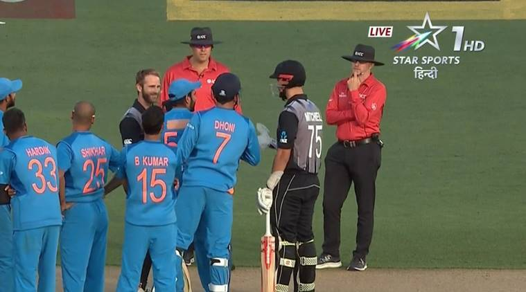 New Zealand's Daryl Mitchell and Kane Williamson with the Indian team during second T20I