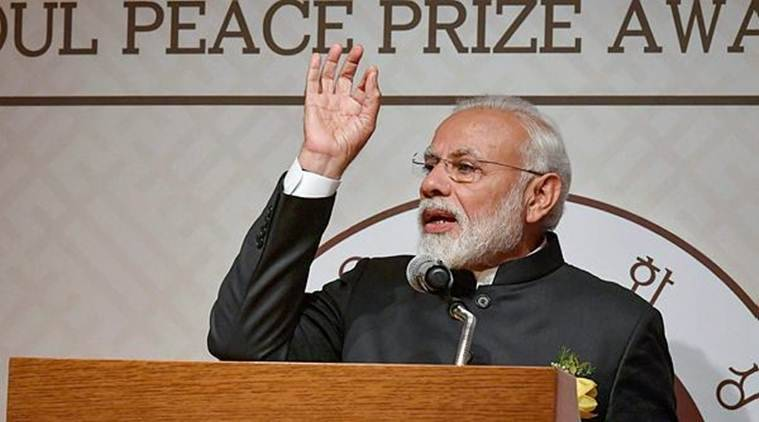 Prime Minister Narendra Modi addresses the crowd after receiving the Seoul Peace Prize at the award ceremony in Seoul on Friday. (PIB/PTI)