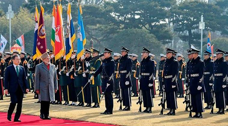 Prime Minister Narendra Modi with South Korean President Moon Jae-in (L), inspects the guard of honour during a ceremonial reception, in Seoul. (PIB/PTI)