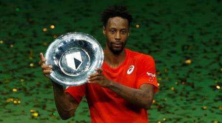 France's Gael Monfils celebrates winning the Rotterdam Open with the trophy