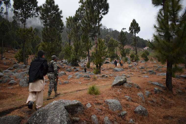 Pakistani reporters and troops visit the site of the Indian airstrike in Jabha, near Balakot, Pakistan, on Tuesday. (AP)