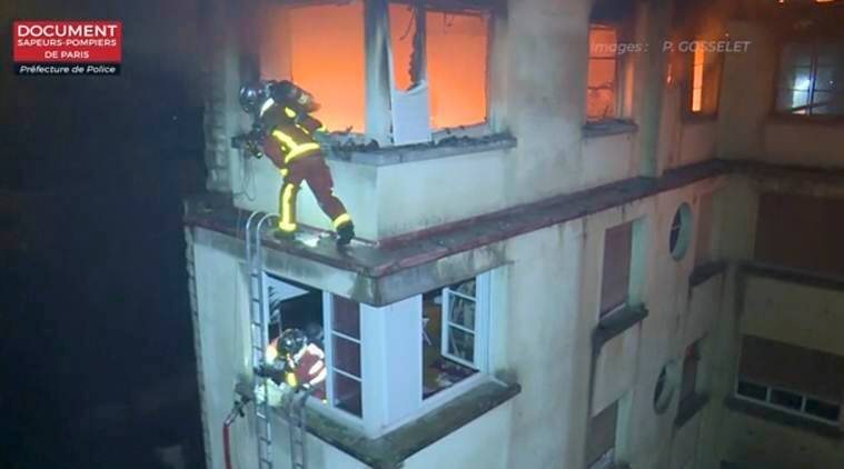 Paris fire kills eight in apartment block, woman detained