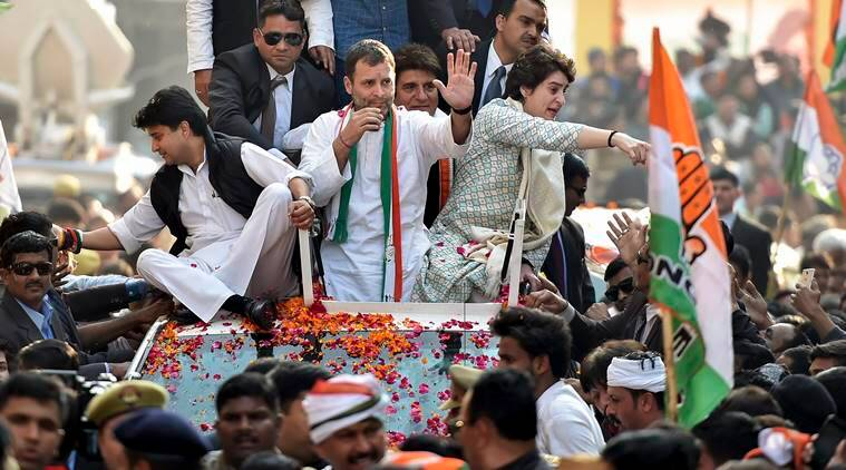 Congress President Rahul Gandhi with party general secretaries Priyanka Gandhi Vadra and Jyotiraditya Madhavrao Scindia during a roadshow, in Lucknow on Monday. (PTI)