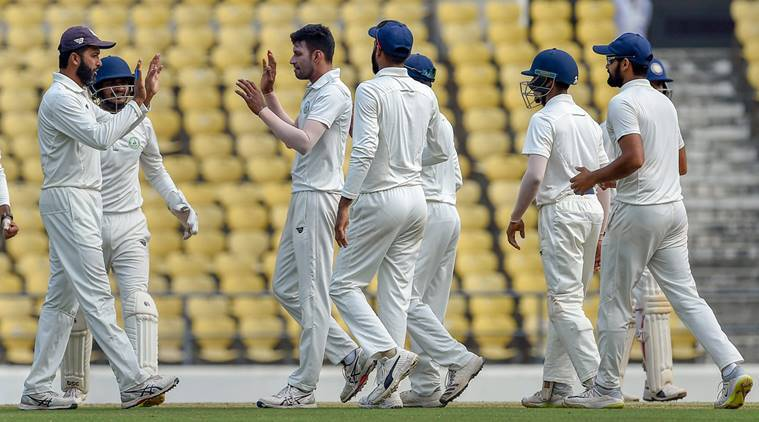 Vidarbha off-spinner Akshay Wakhare celebrates with his teammates the dismissal of Saurashtra batsman Prerak Mankad on the final day of the Ranji Trophy cricket match, in Nagpur