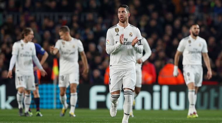 Real Madrid's Sergio Ramos and team mates celebrate their first goal scored by Lucas Vazquez against Barcelona