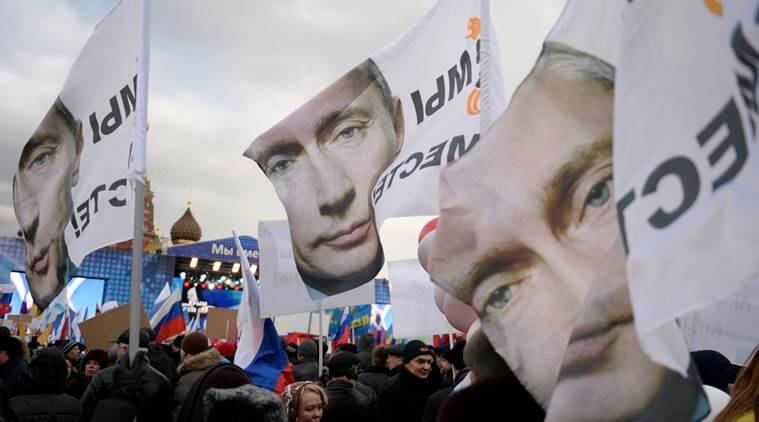 """Banners bear the portrait of President Vladimir Putin and the slogan """"We Are Together,"""" referring to Russia and Crimea, which Russia seized from Ukraine"""