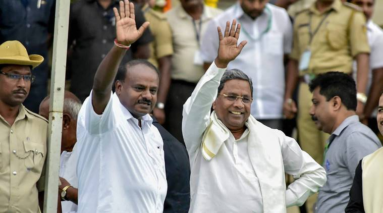 Karnataka Chief Minister H D Kumaraswamy with former chief minister and Congress leader Siddaramaiah during the swearing-in ceremony of JD(S)-Congress coalition government, in Bengaluru, last year.