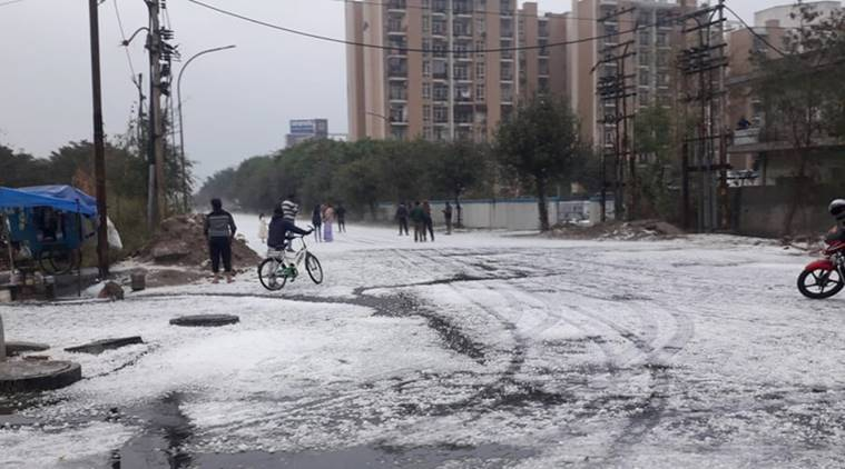 Delhi hail, noida hailstorm, hailstorm in noida, noida rain, delhi hailstorm, delhi weather, noida weather, snow storm, hail storm picture, indian express, indian express news
