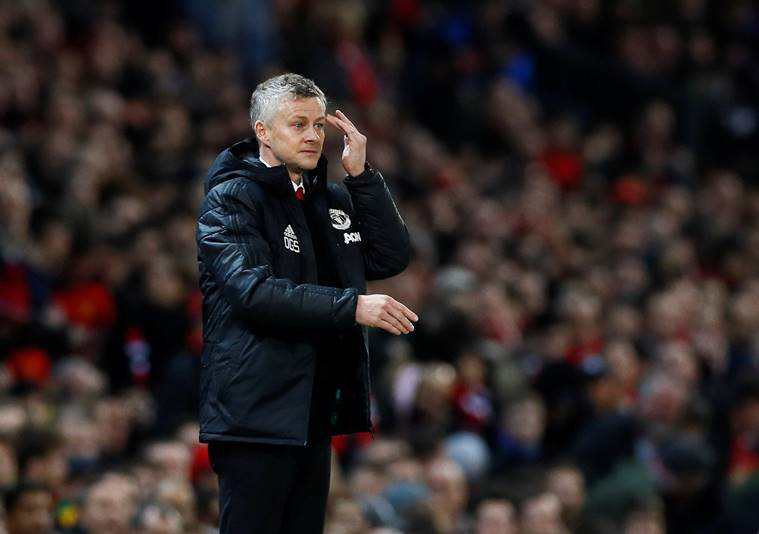 Manchester United interim manager Ole Gunnar Solskjaer gestures during the game against PSG