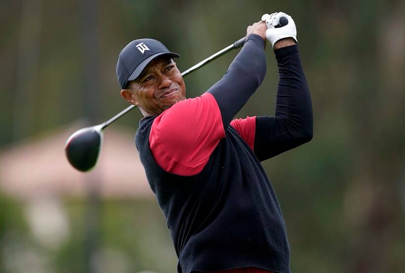 Tiger Woods tees off on the 17th hole during the final round of the Genesis Open golf tournament at Riviera Country Club on Sunday