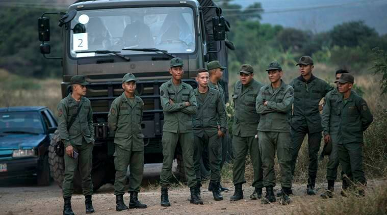 Two killed as Maduro sends troops to block Venezuela aid convoys
