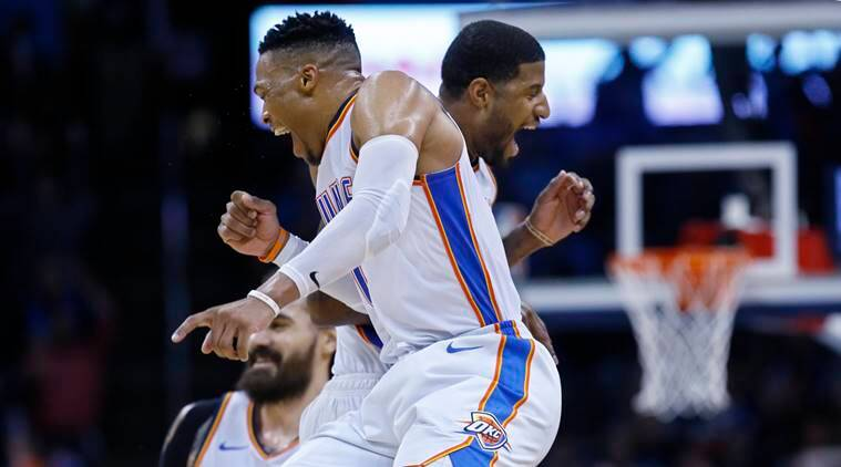 Oklahoma City Thunder guard Russell Westbrook, left, and forward Paul George, right, celebrate late in the second half of an NBA basketball game against the Portland Trail Blazers in Oklahoma City