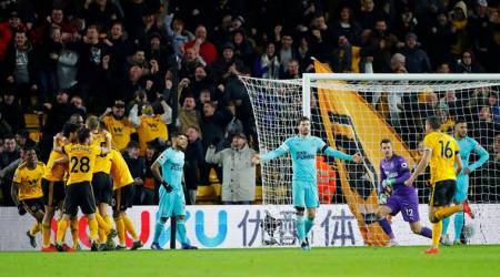 Wolverhampton Wanderers' Willy Boly celebrates scoring their first goal with team mates as Newcastle players look dejected