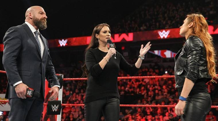 Stephanie McMahon and Triple H in the ring with Becky Lynch on WWE Raw