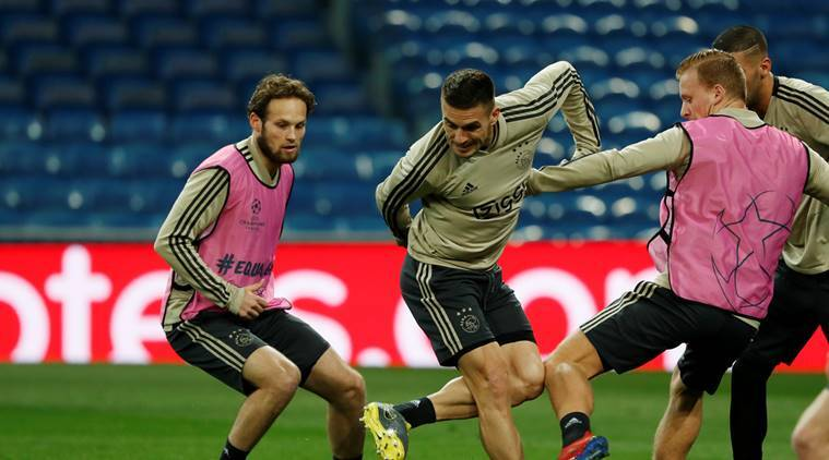 Ajax Amsterdam's Dusan Tadic and Daley Blind during training