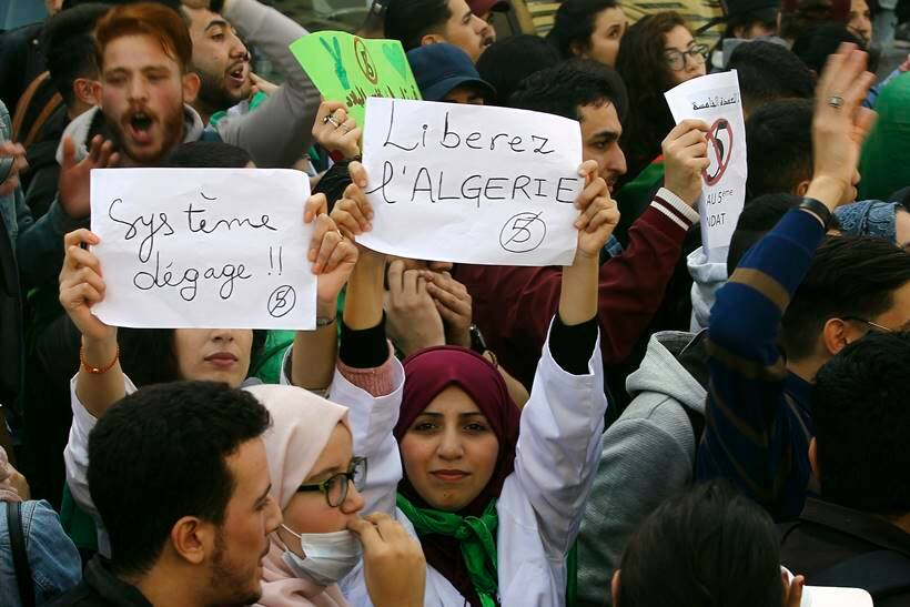 Algerian protestors celebrate as President Abdelaziz Bouteflika announces he won't seek another term