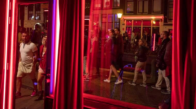 Amsterdam is to ban tours of the red-light district