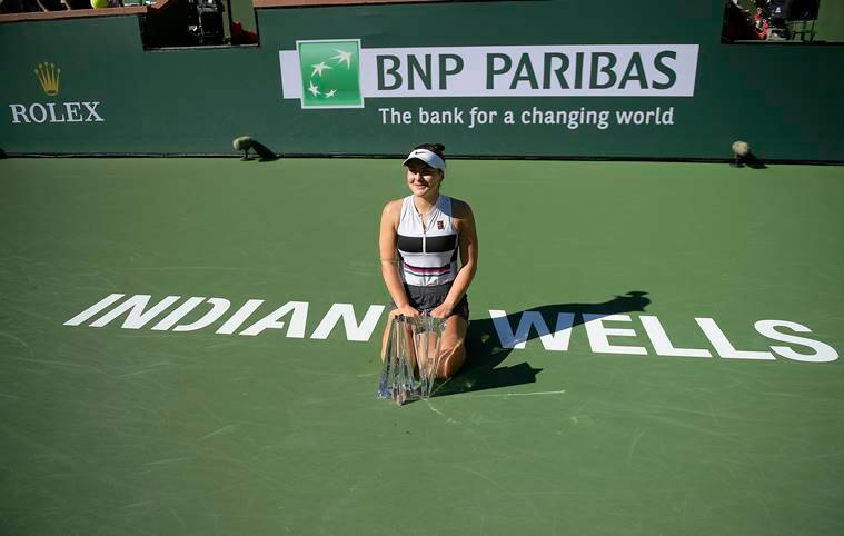 Bianca Andreescu, of Canada, poses for photos with her trophy after defeating Angelique Kerber, of Germany, in the women's final at the BNP Paribas Open tennis tournament