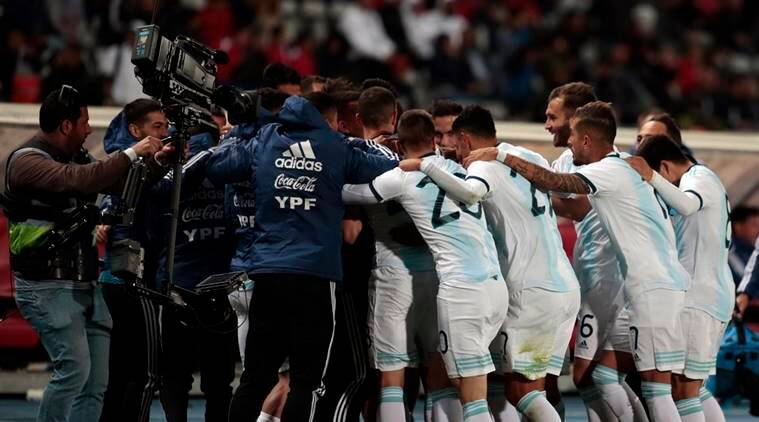 Argentina's players celebrate their goal during an international friendly soccer match between Morocco and Argentina in Tangier, Morocco.