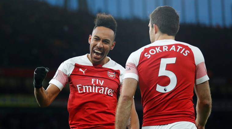 Arsenal's Pierre-Emerick Aubameyang celebrates scoring their second goal against Manchester United with Sokratis Papastathopoulos