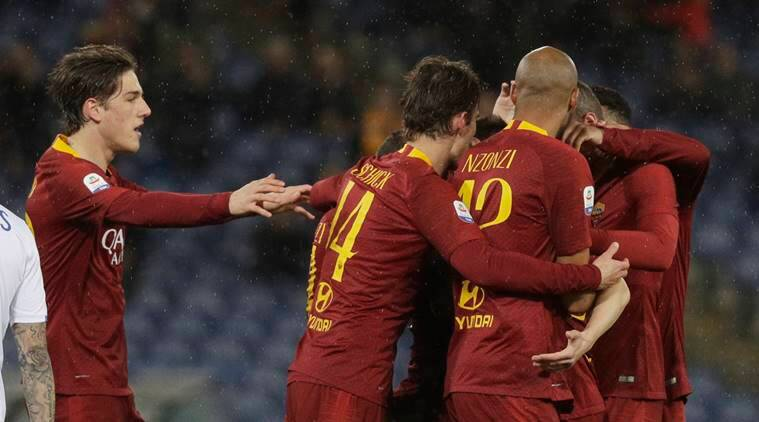 Roma's Stephan El Shaarawy, covered, celebrates with teammates after scoring during an Italian Serie A soccer match between Roma and Empoli, at the Olympic stadium in Rome