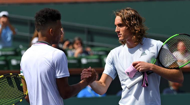 Felix Auger-Aliassime and Stefanos Tsitsipas at the net following their meeting in Indian Wells