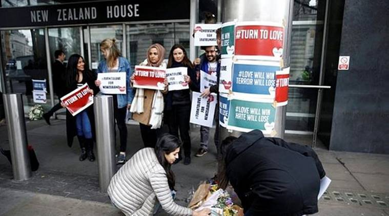 People lay flowers outside New Zealand House, following the Christchurch mosque attack in New Zealand, in London, on Friday. (Reuters)