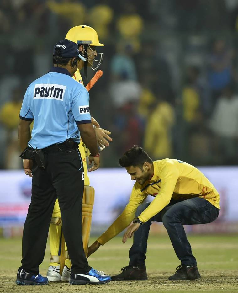 A pitch invader touches feet of CSK caption MS Dhoni after his team won their match of the Indian Premier League (IPL T20 2019) between Chennai Super Kings (CSK) and Delhi Capital (DC) at Feroz Shah Kotla Cricket Stadium.