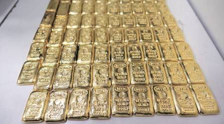 gold, gold smuggling, duty free officer, gold smuggling at igi airport, igi airport smuggling, indian express
