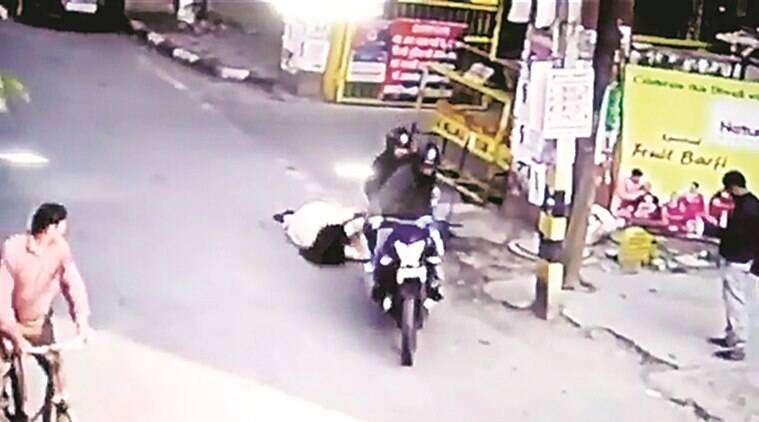 Footage from a nearby CCTV camera shows the woman waiting outside a residential colony when the men, wearing helmets, approach her on a motorcycle.