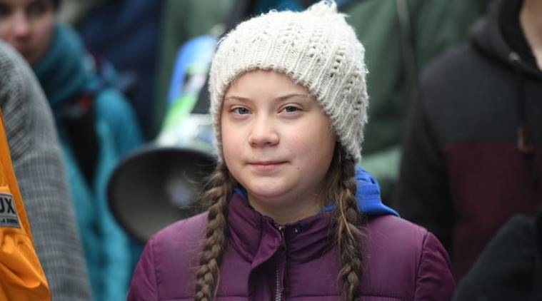 Swedish climate activist Greta Thunberg attends a protest rally in Hamburg Germany Friday