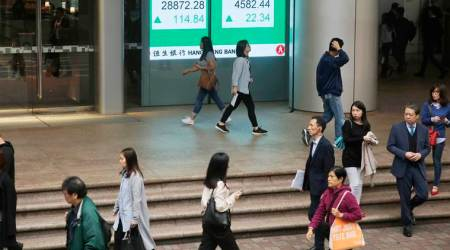 GLOBAL MARKETS - Asian shares fall on fresh rout in crude prices, End in sight for some lockdowns, Oil suffers as USO ETF sells front-month futures, Markets eye Fed and ECB meetings this week, world markets tuesday, business news india, indian express business news